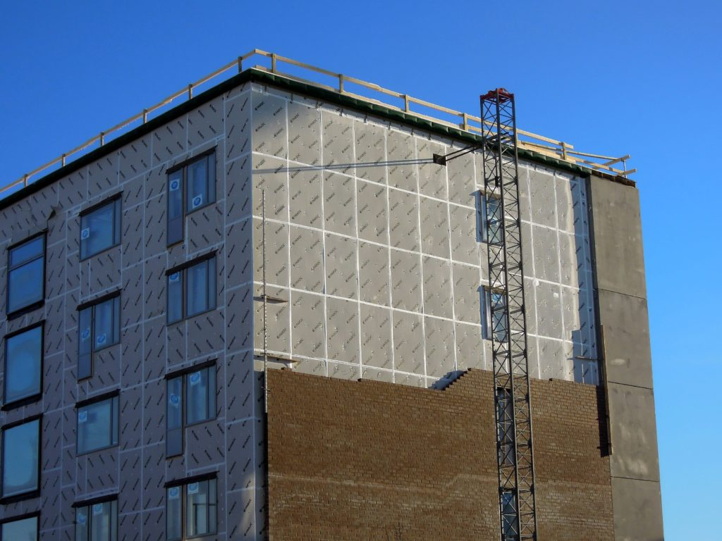 rigid panel applied on the exterior walls