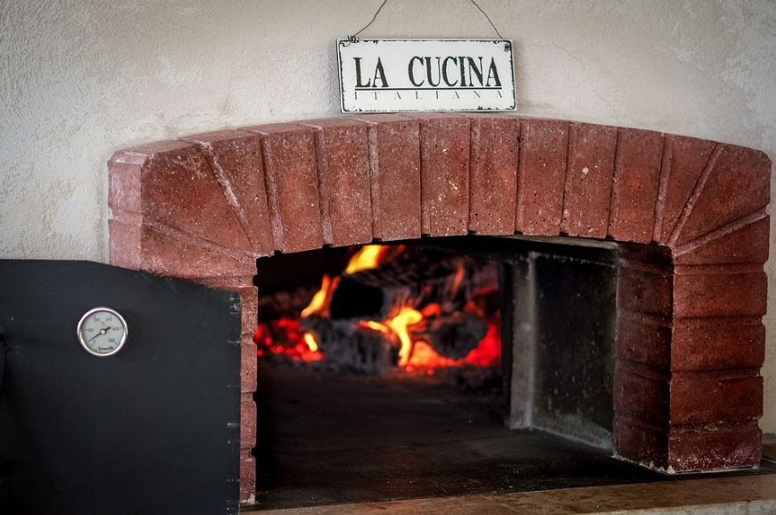 Picture of a lighted-up pizza brick oven