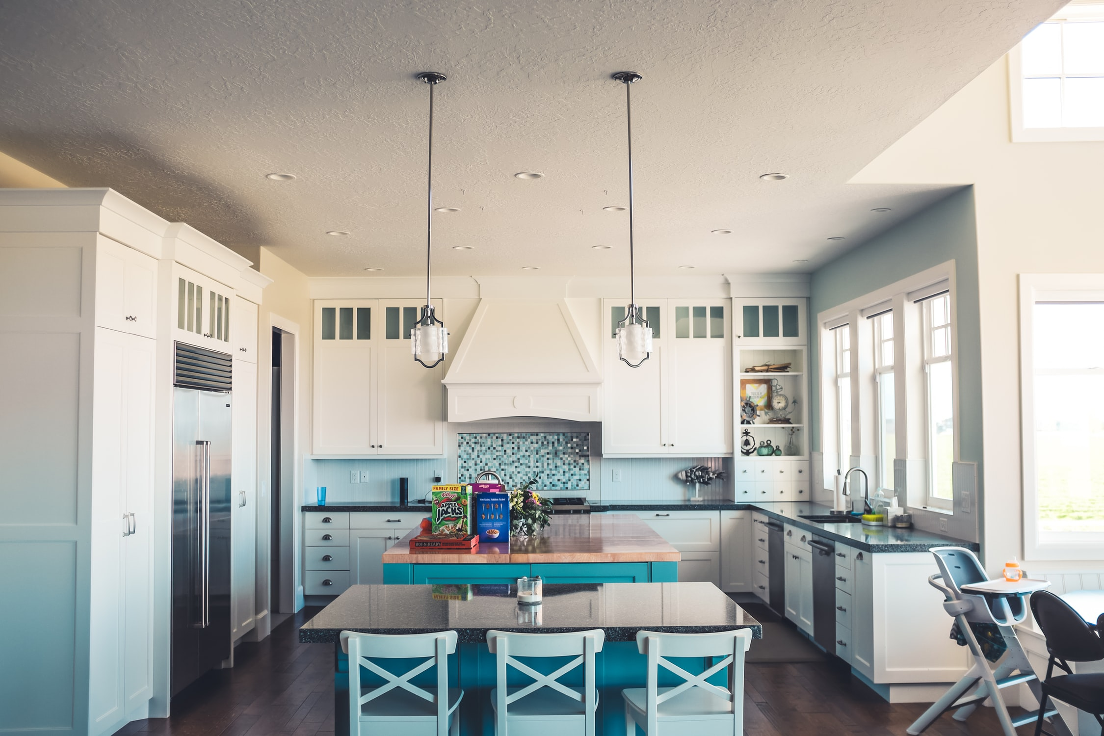 a big kitchen with two pendant lights
