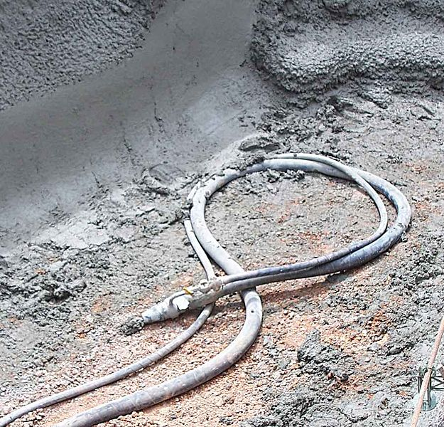 What is shotcrete and what are the two methods of shotcreting